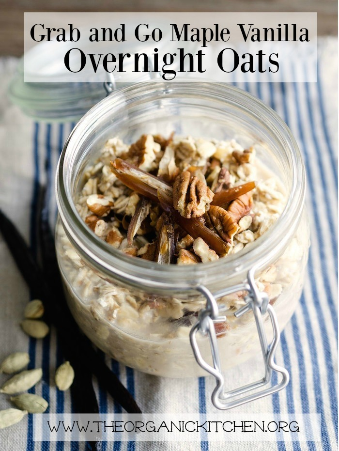 A mason jar filled with Grab and Go Maple Vanilla Overnight Oats on blue and white cloth!