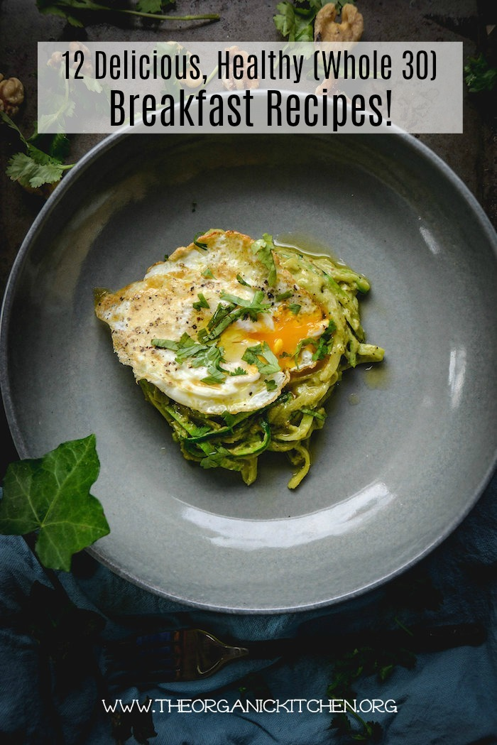 Zucchini noodles and fried egg on a grey plate as part of 12 Healthy, Delicious (Whole 30) Breakfast Recipes