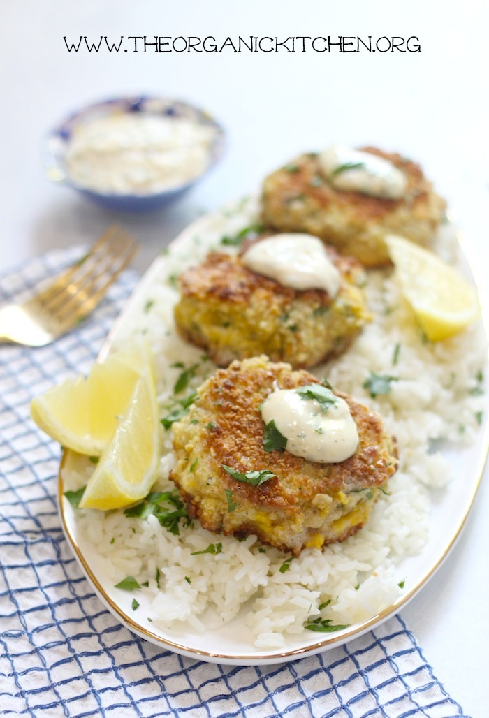 Three crab cakes topped with a dab of aioli