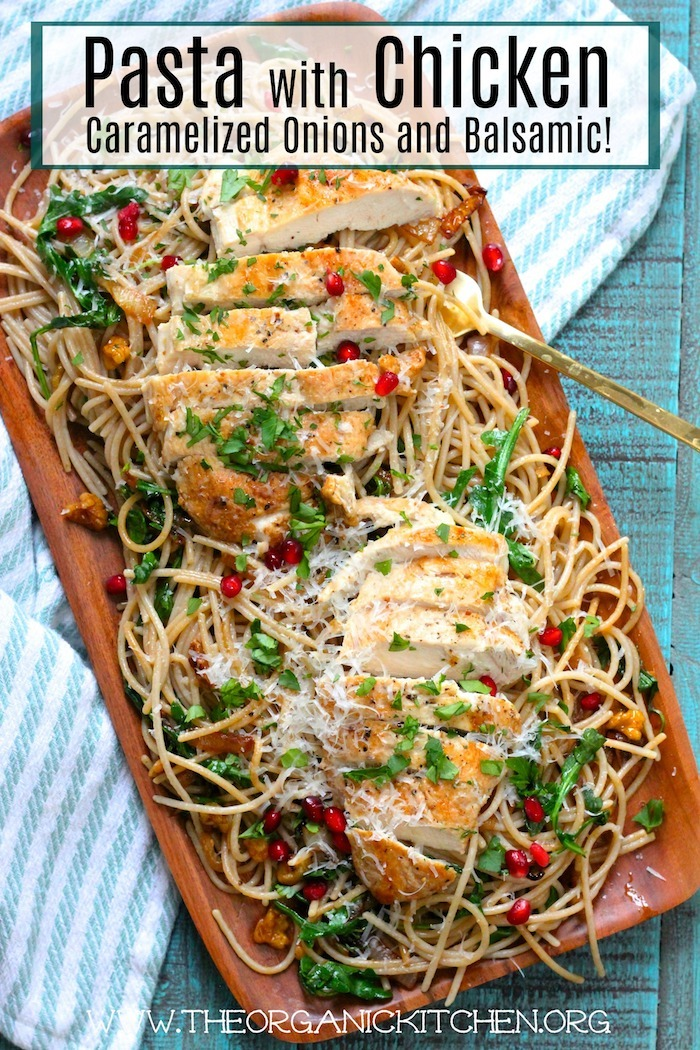 Pasta with Chicken, Caramelized Onions and Balsamic on a wooden platter set on a blue table