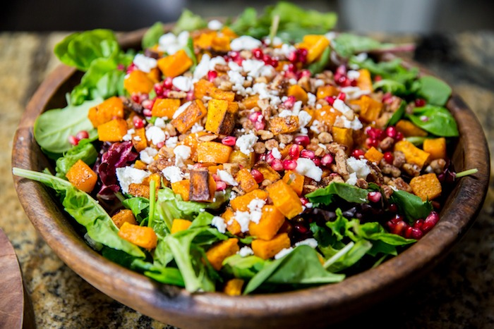 Greens with Butternut Squash and Pomegranate Vinaigrette! #butternutsquash #salad #glutenfree #pomegranatevinaigrette #sundanceutah