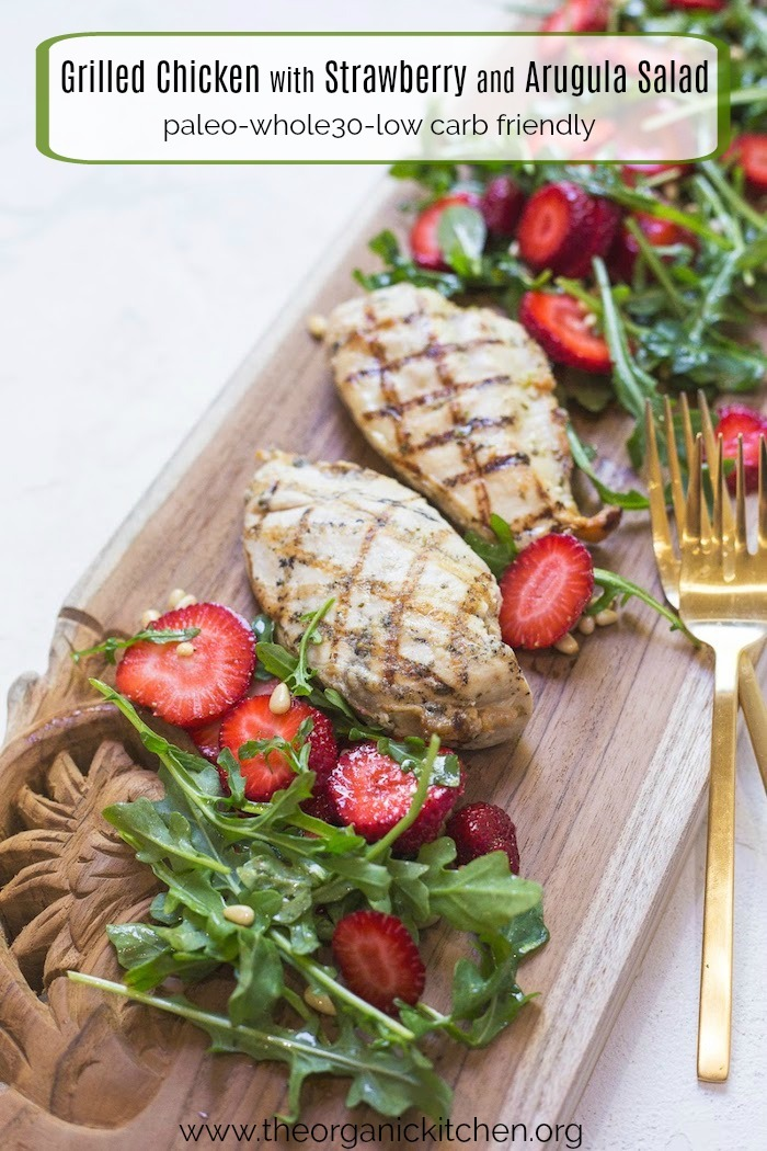Grilled Chicken with Strawberry and Arugula Salad on a wodden serving board