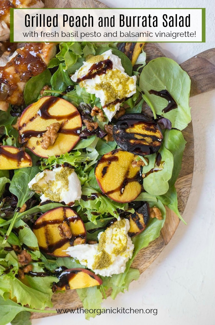 Grilled Peach and Burrata Salad on wooden serving board set on white background