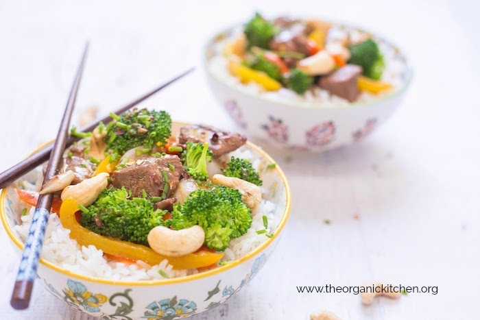 Two bowls of Thai Beef and Broccoli Rice Bowl with chop sticks