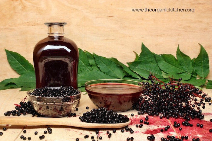 Elderberry Syrup with Low Carb Option in glass jar surrounded by elderberries