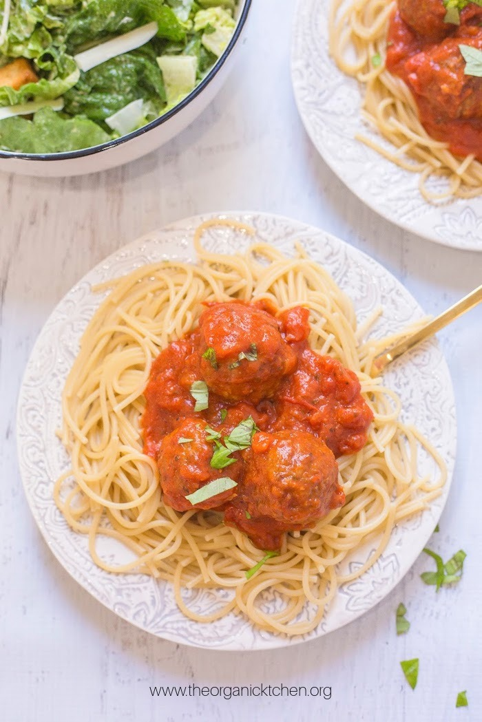 Spaghetti with Homemade Meatballs on white plate with gold fork