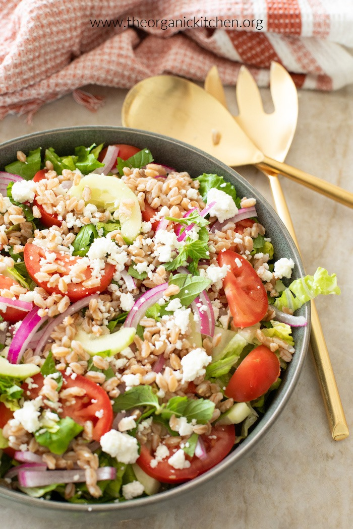 Chopped Greek Salad with Farro on marble surface
