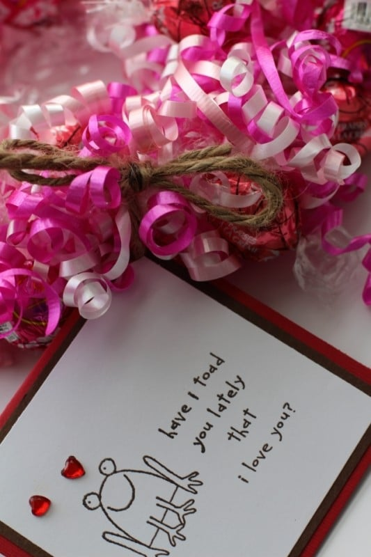Candy Wreath Card attached to Valentine's day wreath made of curling ribbon in dark pink, light pink, and white