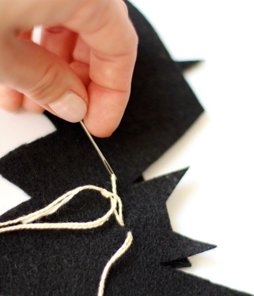 Halloween Craft Tutorial Bat Mobile - Tying String To Bat