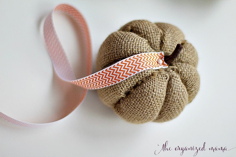 fall pumpkin DIY adding ribbon to burlap pumpkin