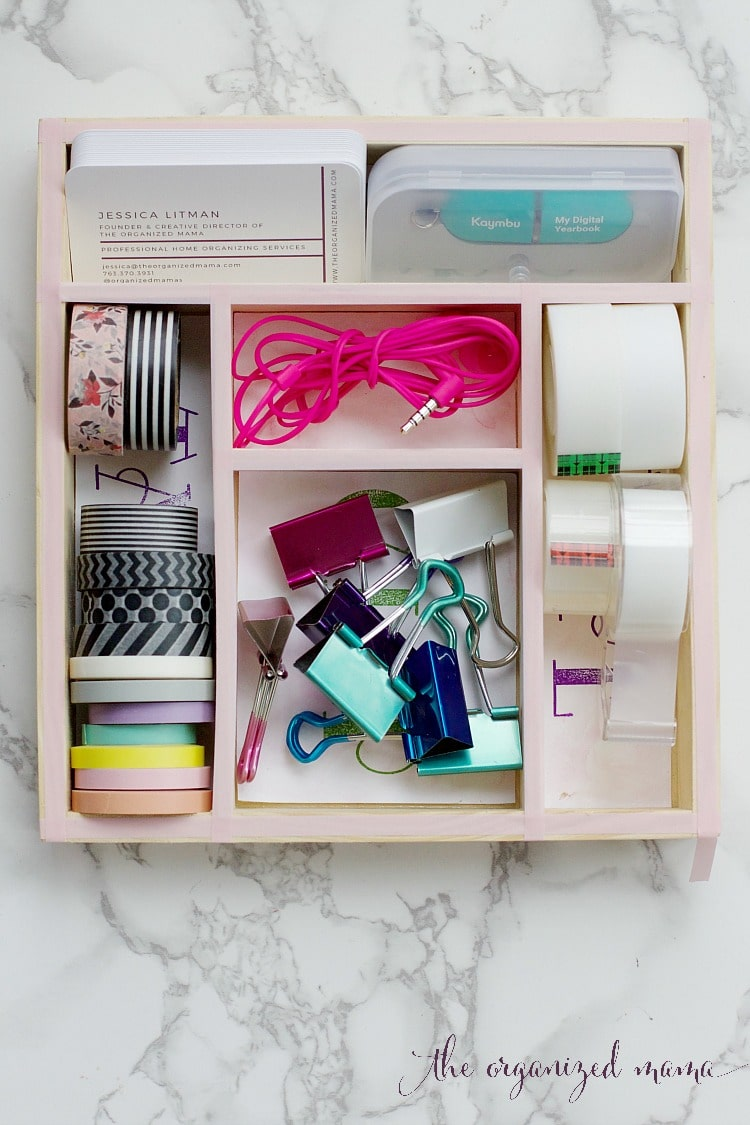 Get that desk drawer organized with custom drawer organizers that you can make yourself! Use kids stamp boxes, paper, and decorative stamps to create one-of-a-kind custom drawer organizers! #drawerorganizer #organized