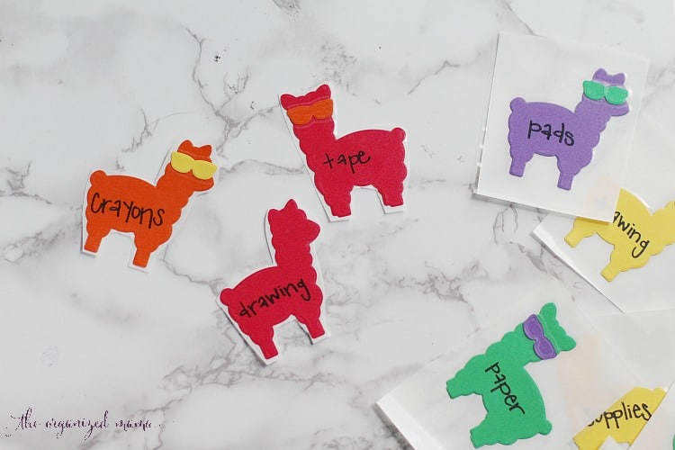 cut out each individual llama label from xyron creative station