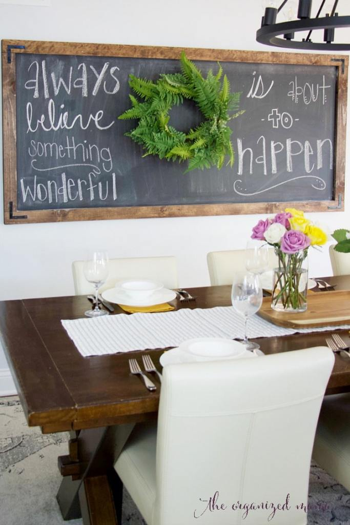 simple extra large chalkboard in dining room with quote and table setting