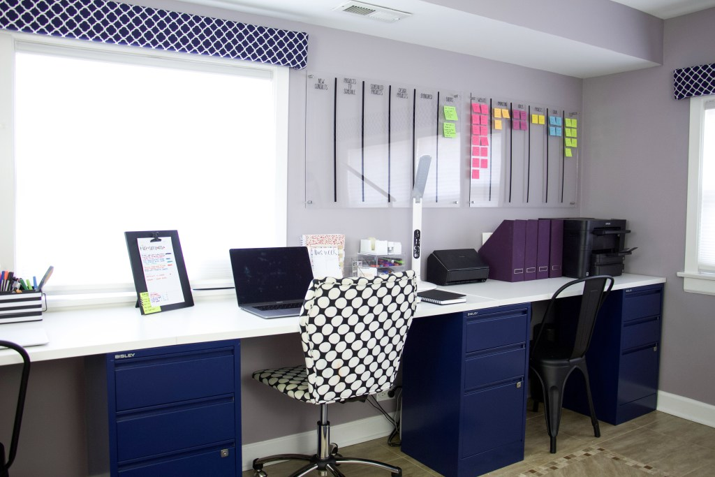 Extra long DIY computer desk with three chairs and project board. Project board is over one corner of desk with color-coded post it notes. #projectboard #commandcenter