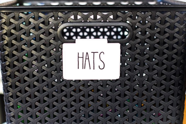 instant download sticker labels with capital font adhered to bin clip on black bin