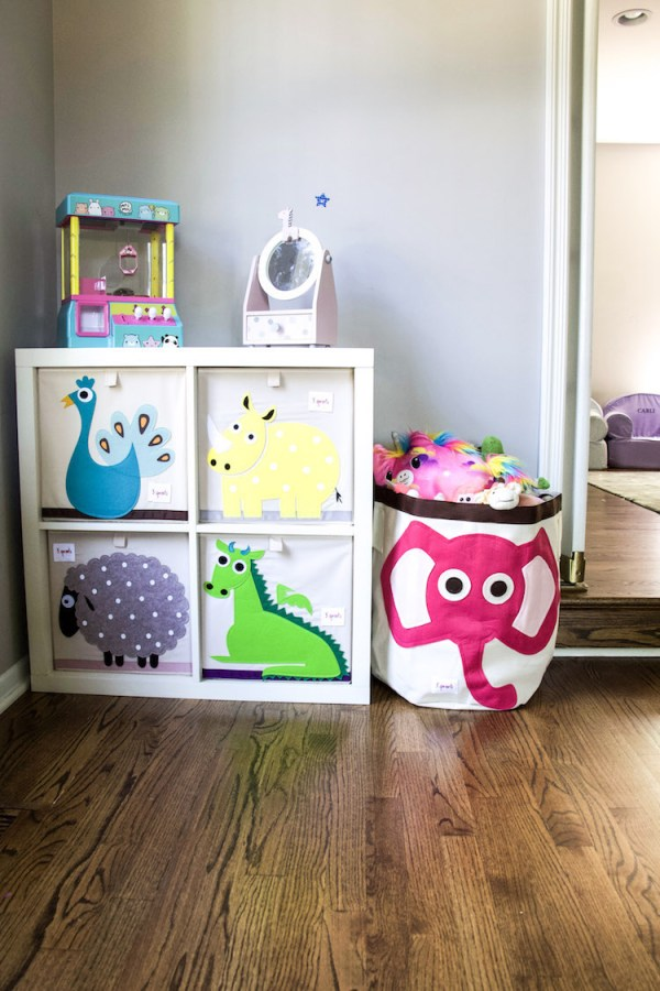 playroom with The Container Store cubes and 3 Sprouts bins holding different categories of toys #organized