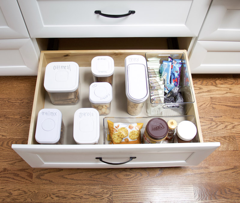Kitchen pantry drawer open with containers and drawer organizers inside and bottom has easyliner on bottom to hold everything in place