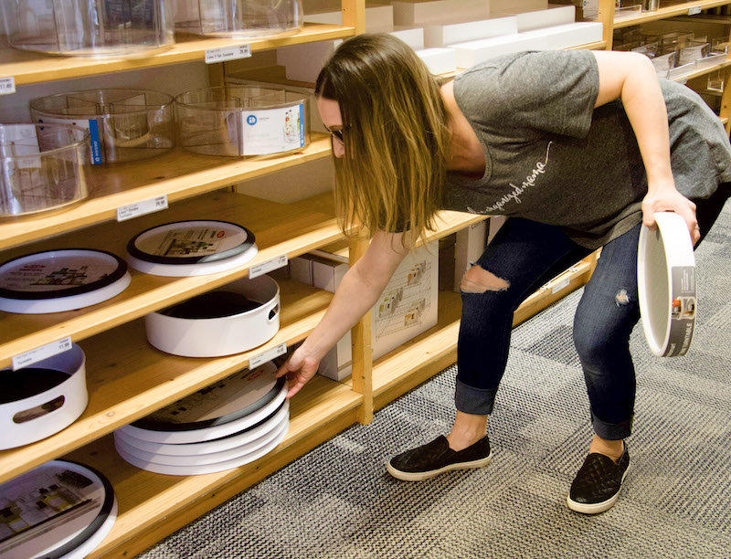 Professional organizer shopping in the kitchen aisle at The Container Store for lazy Susan turntables #organized