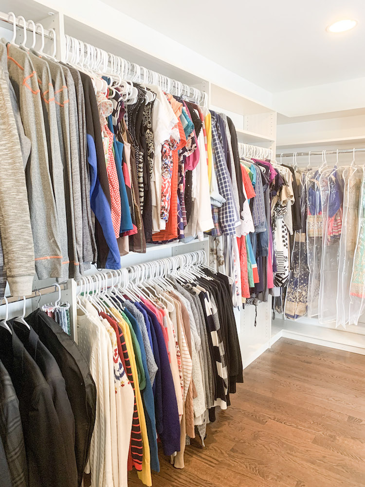 closet with hanging clothing