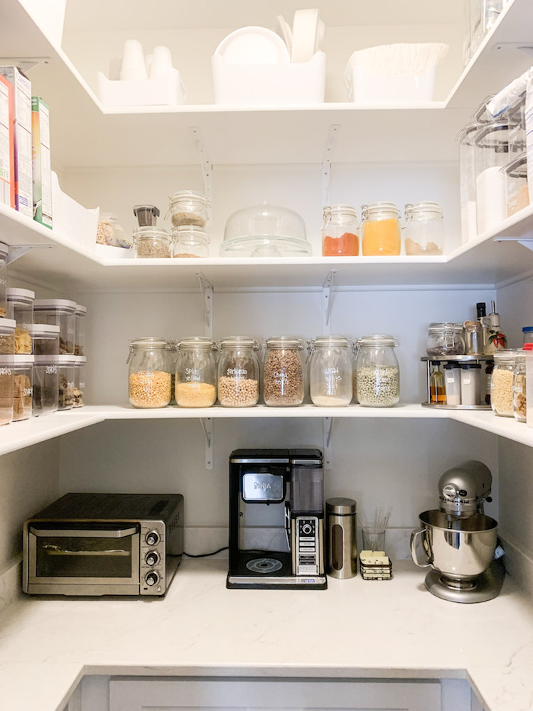 Tidy pantry shelves with clear, labelled containers