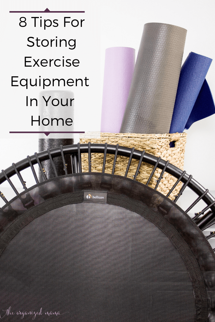 8 tips for storing exercise equipment in your home overlay with basket of yoga mats and rebounder pictured