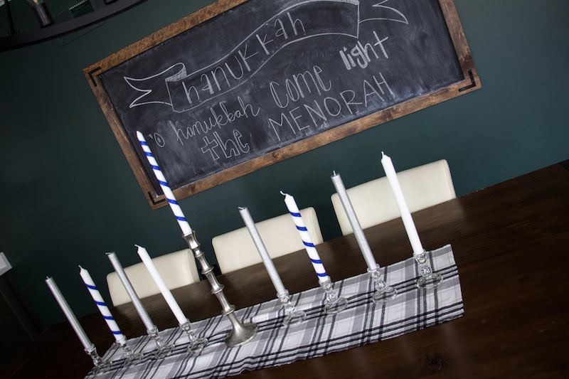 hanukkah table decor with menorah using tall candles