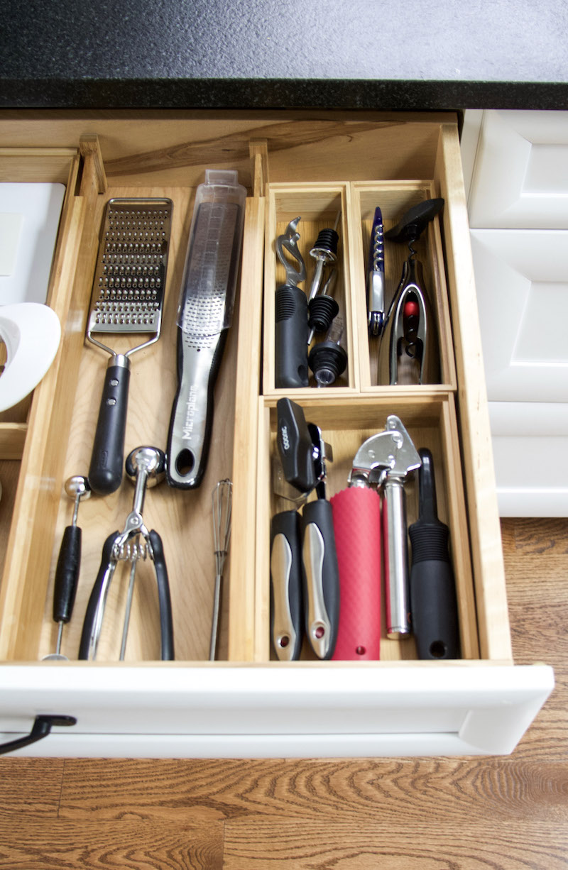 kitchen utensils organized in boxes and bamboo drawer dividers #sustainable #organized