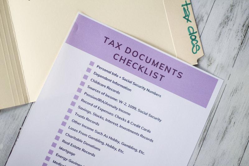 tax documents checklist on top of file folder #taxseason