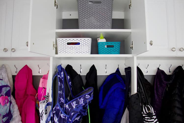 Baskets and empty spaces in open mudroom cabinet #organizedmudroom