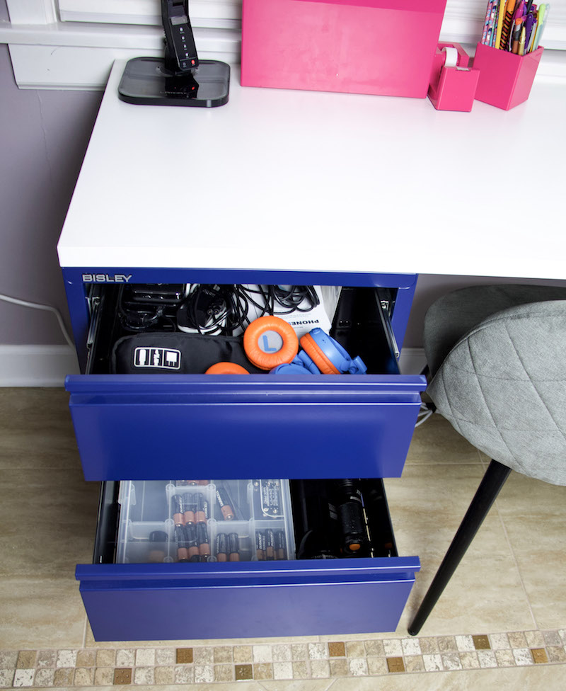 desk drawer with batteries and electronic cords