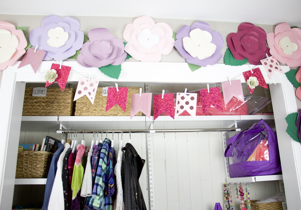 closet with paper flowers above