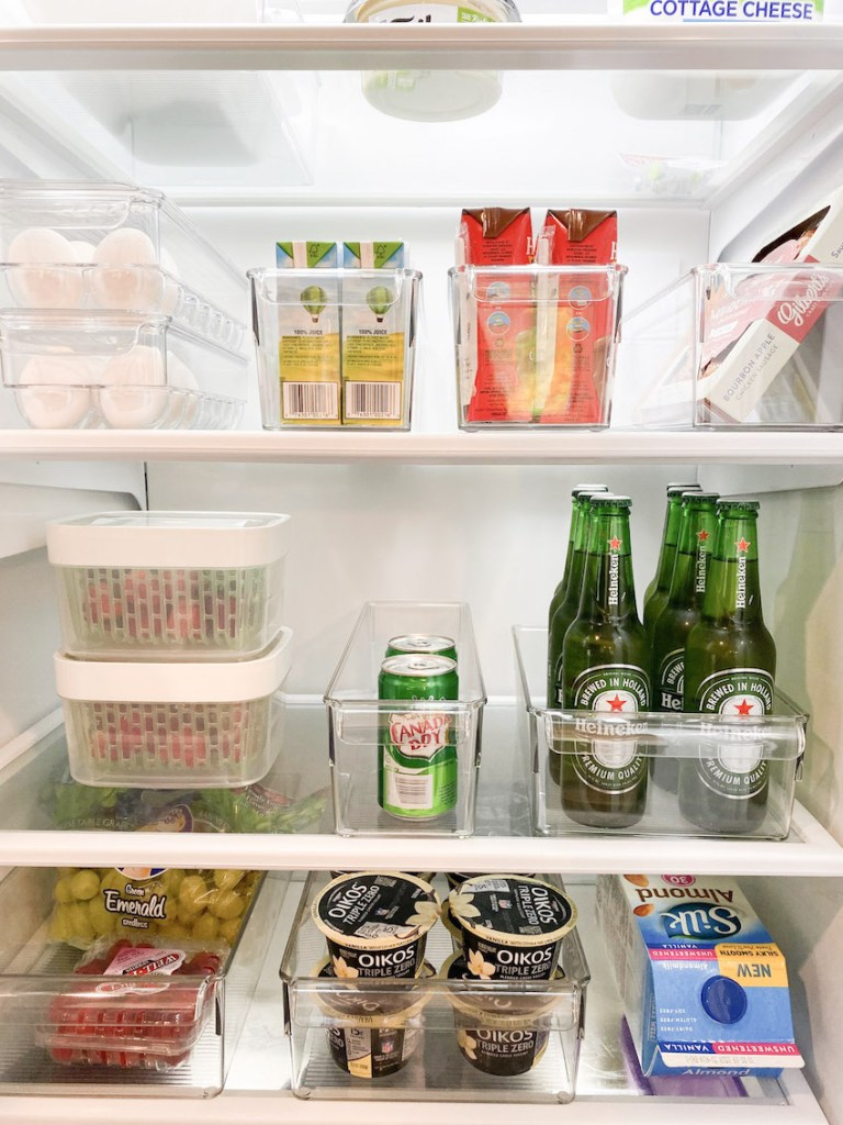 Tidy fridge shelves with clear organizational compartments
