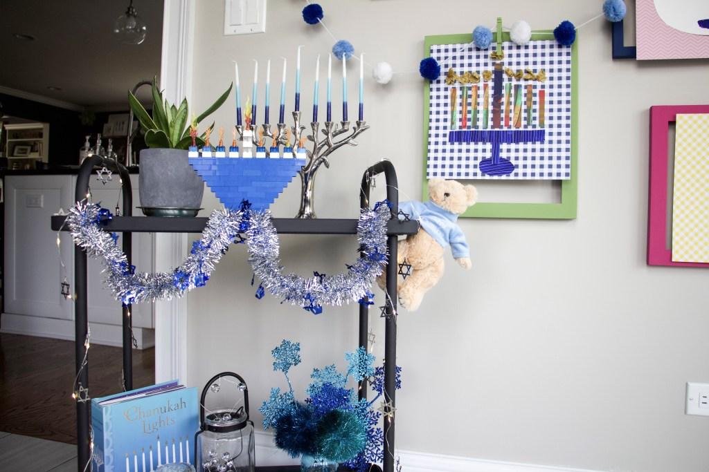 Hanukkah decorations using a cart and garland