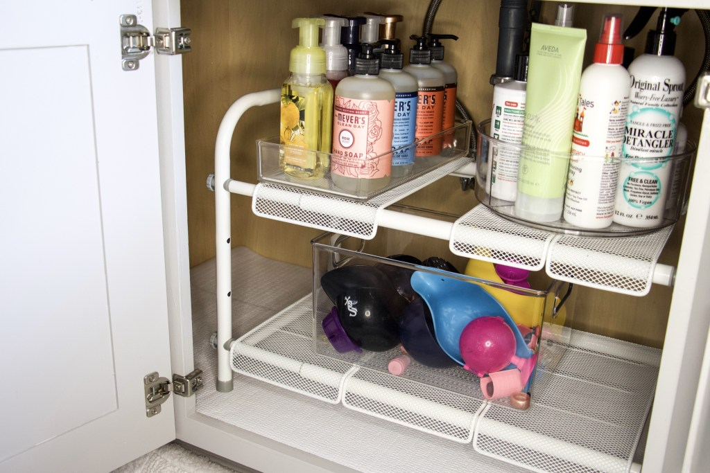 bathroom under sink storage with organizers and turntables