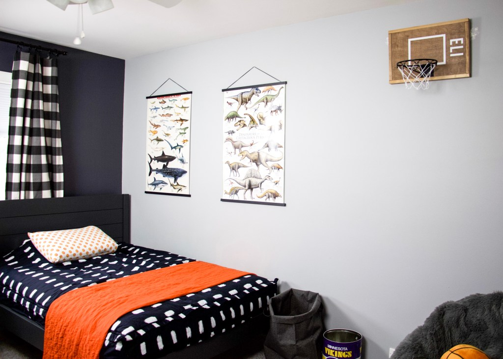 full room picture with posters and basketball hoop hanging on wall in boys bedroom