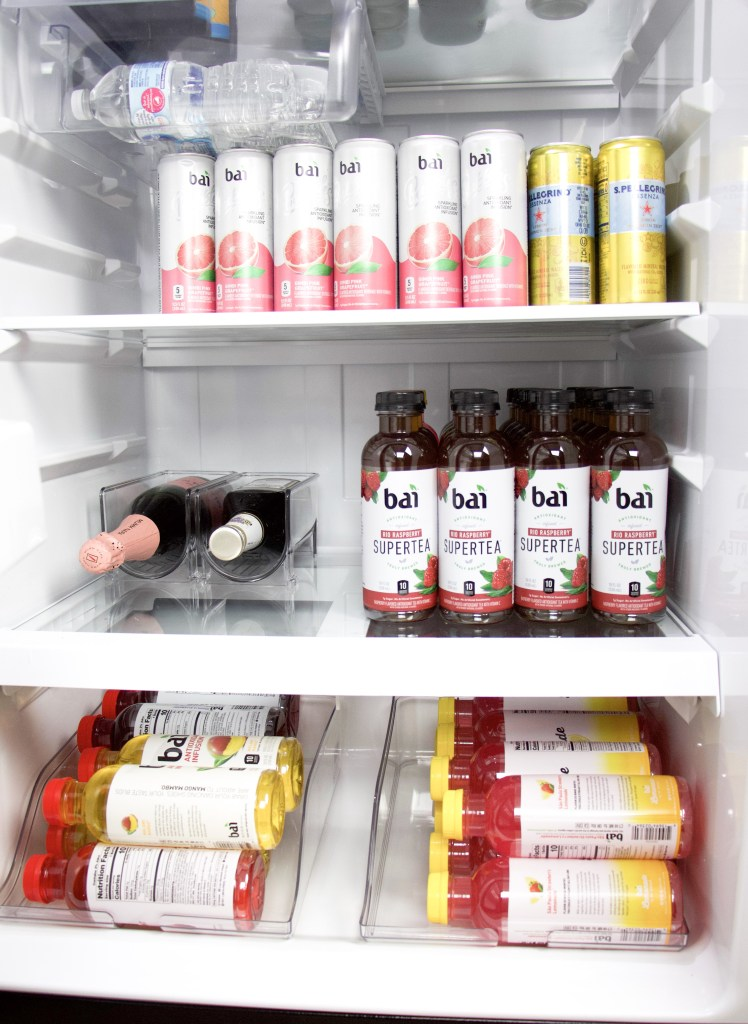 fridge with drinks lined in rows and organizers for wine