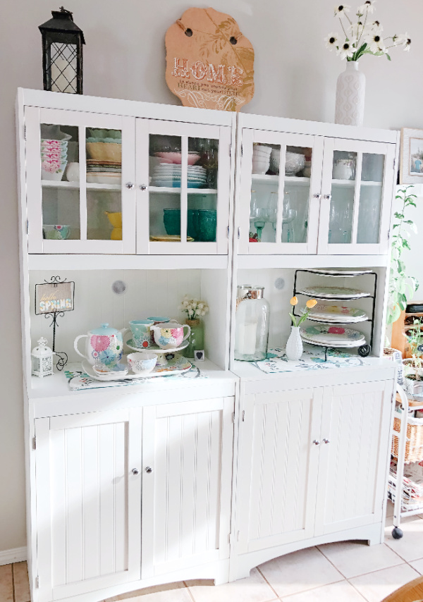 organized junkie hutch with plates and platters
