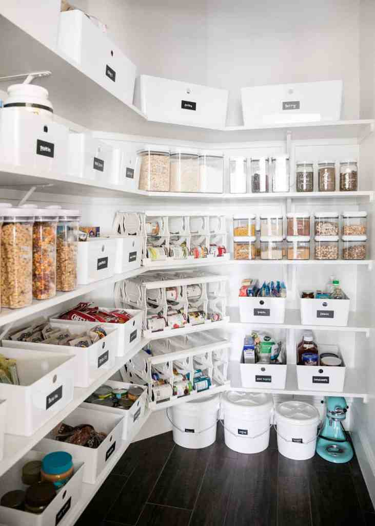 walk in pantry organized with white bins