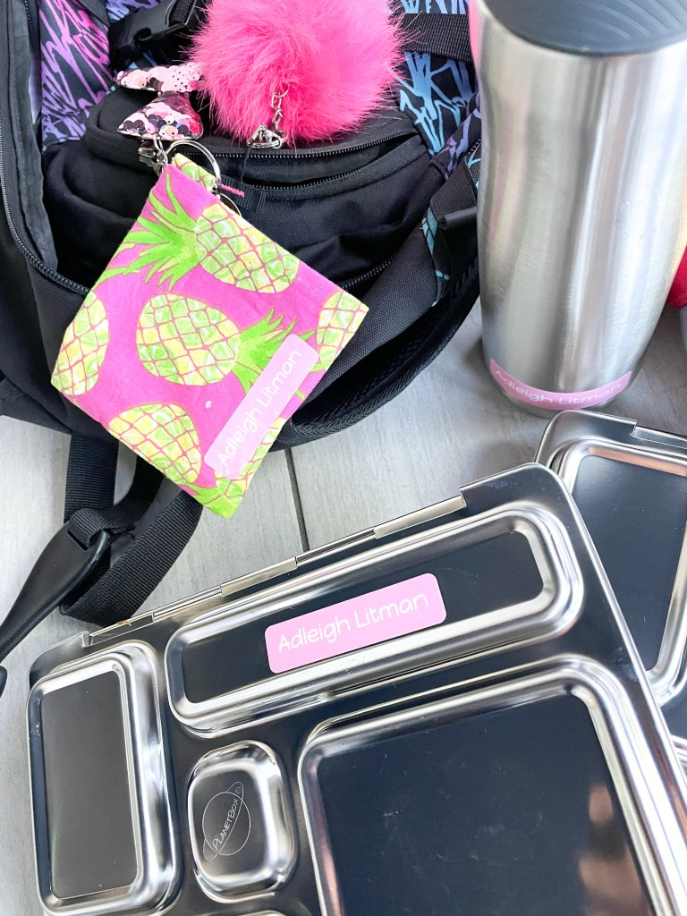 close up of pink label on lunch box and water bottle