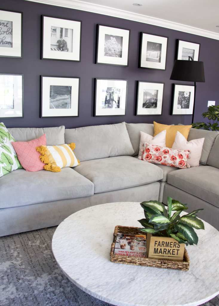 couch with gallery wall and colorful pillows