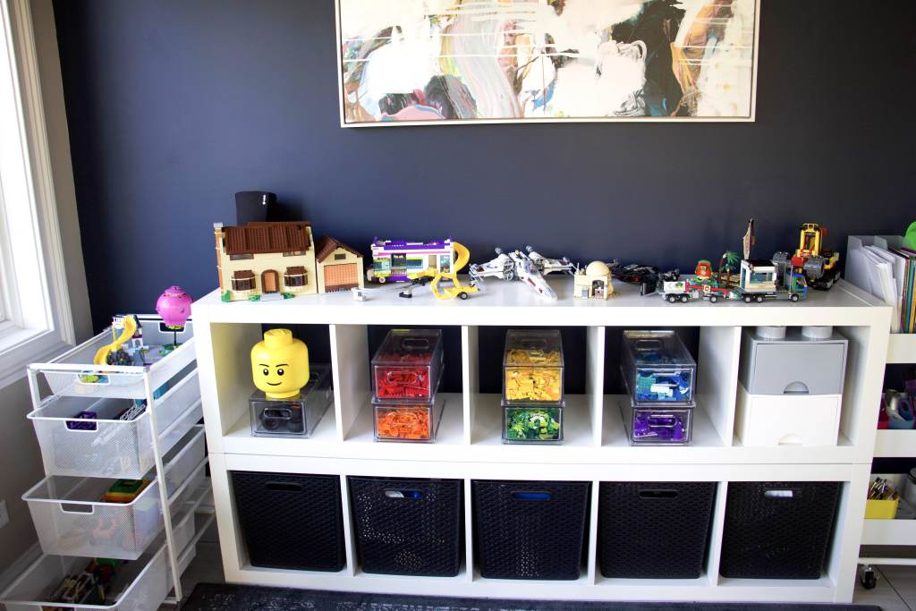 lego creations with color-coded Lego bricks on ikea kallax shelving