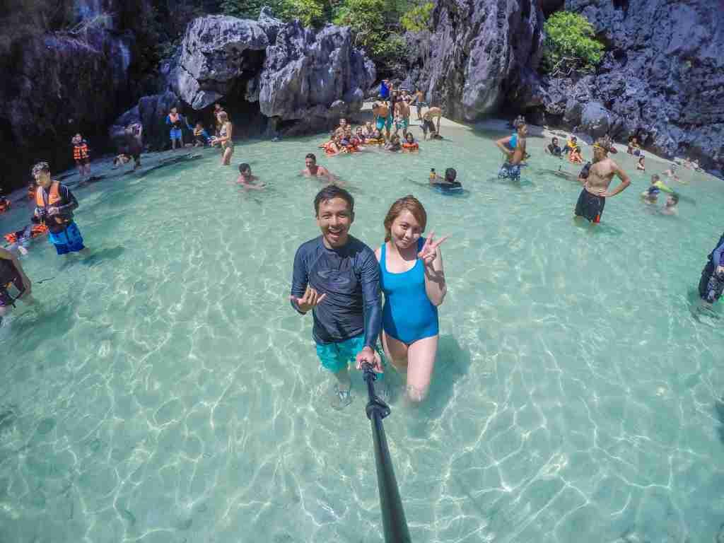 many people swimming in secret beach el nido palawan
