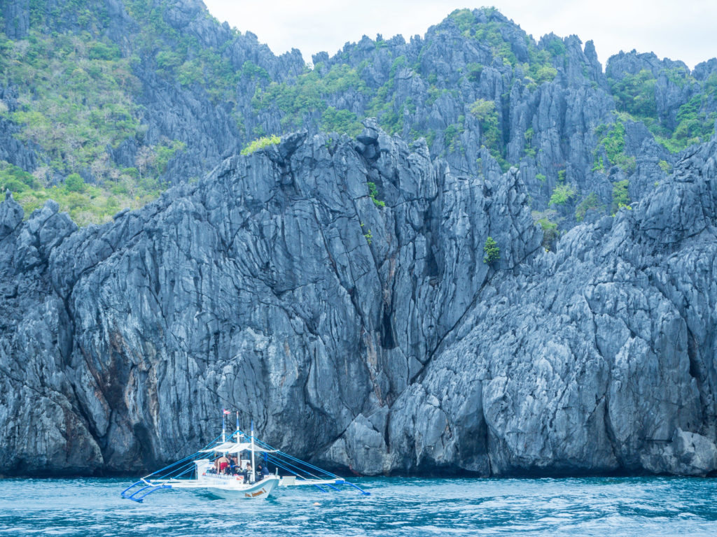 huge rock formations of shimizu island in el nido