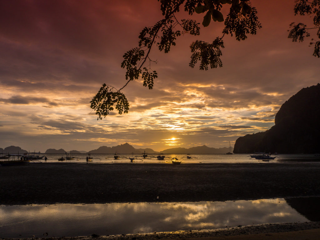 sunset in marimegmeg beach el nido palawan