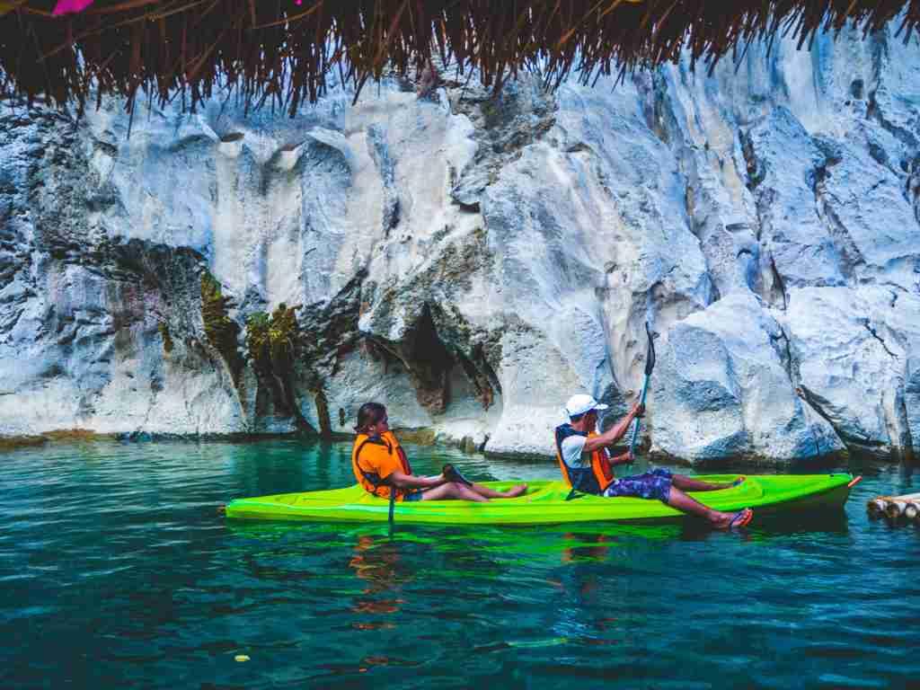 green kayak in the sumacbao river in nueva ecija