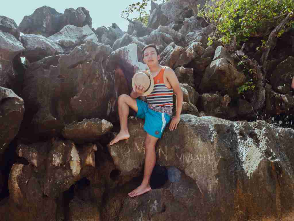 photo on the top of the rock formation in matukad island in caramoan