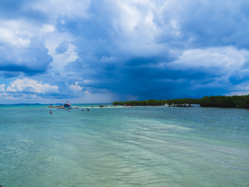 white sandbar in alibijaban island in san andres quezon