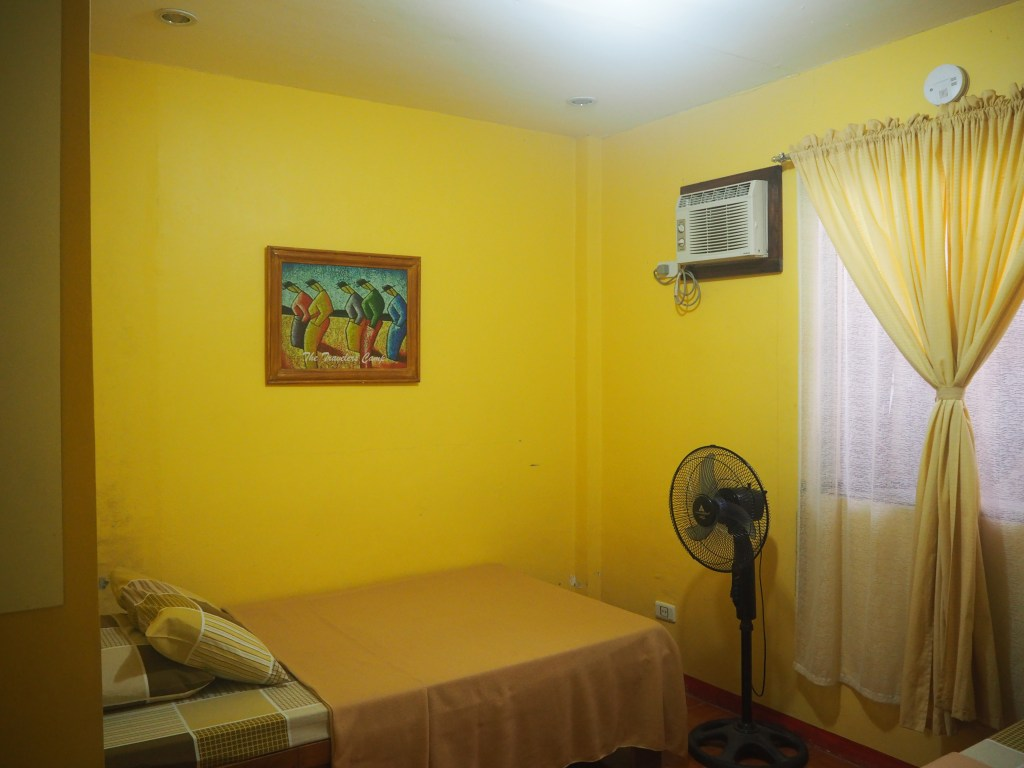 travelers camp single bed room with air condition low budget accommodation in caramoan