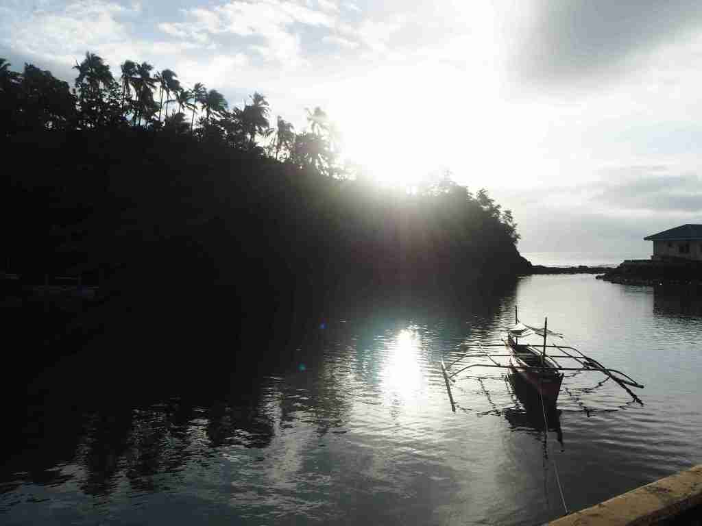 sunlight in the feeder port with boat