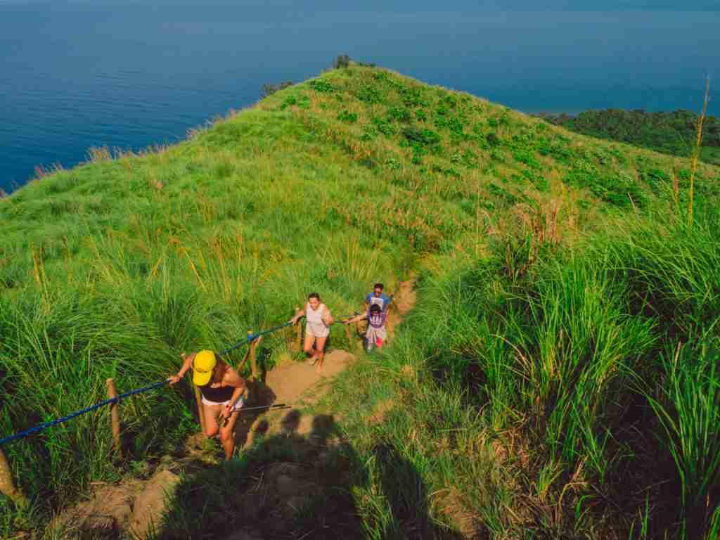 climbing mountain grassland slopes in dingalan aurora